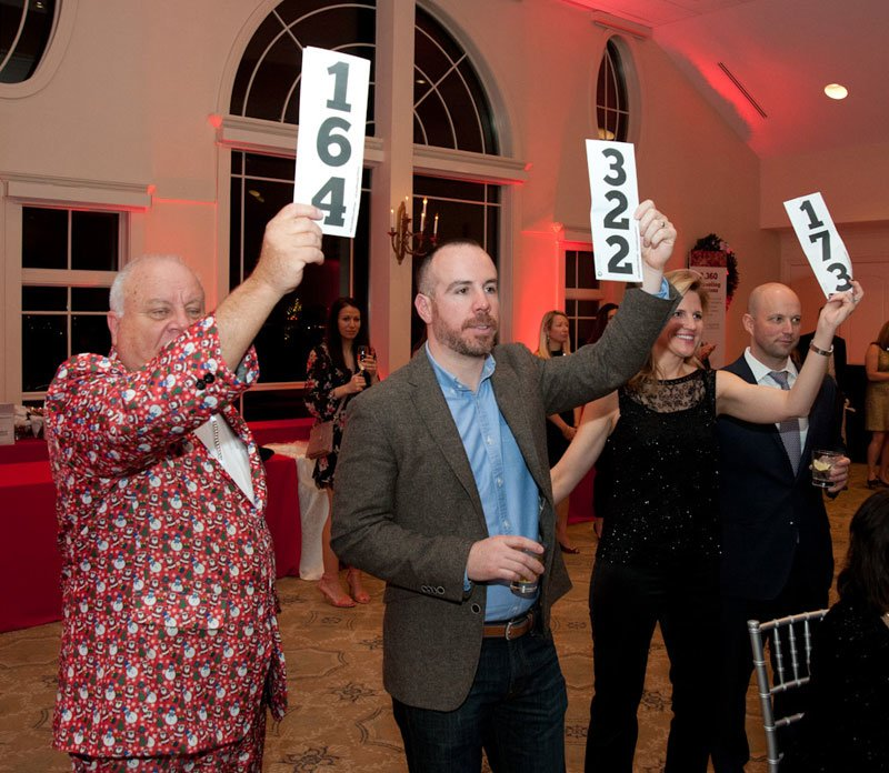 Guests pledge donations to the Fund the Need.