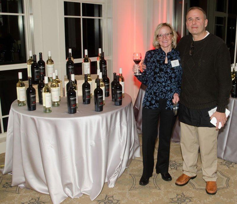 Linda Blais and Matt Witkowski manned the Wine Toss game. Photo by FayFoto Boston.