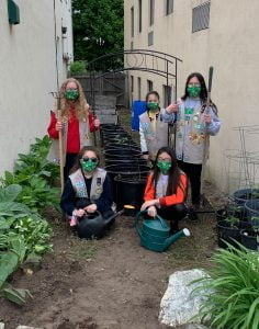 Quincy Girl Scouts pose in Interfaith's alleyway garden