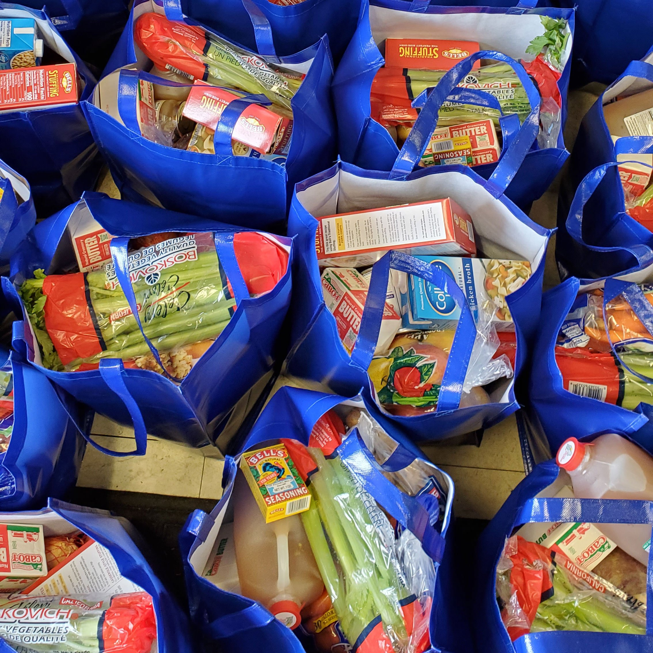 Thanksgiving meal packages donated by Chef Paul Wahlberg