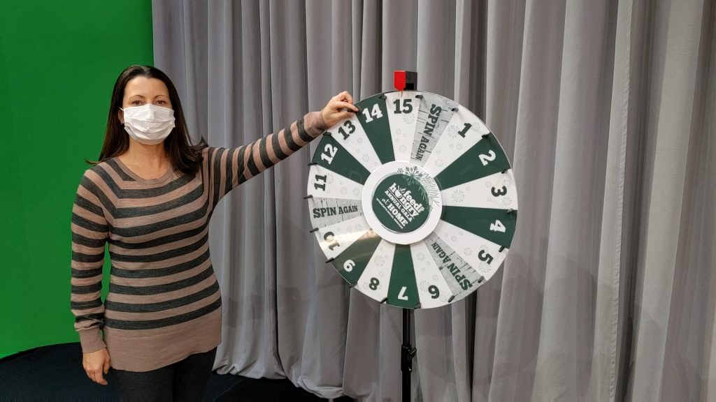 Paula Daniels spins the Wheel of Chance