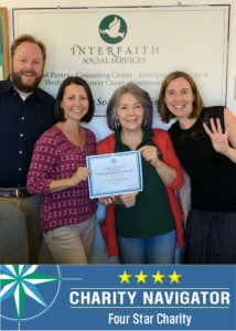 Interfaith Executive Director Rick Doane, Development Director Paula Daniels, Food Pantry Manager Eileen Kelly and Development Associate Jennifer Sammons celebrate the four-star rating.