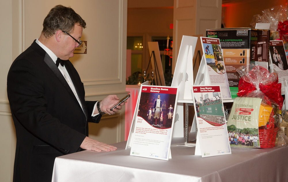 A guest browses (and hopefully bids on!) the silent auction items.