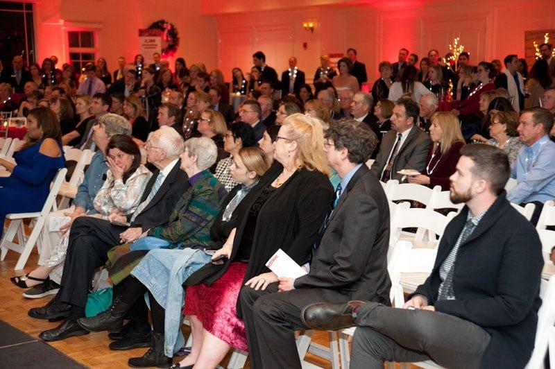 Attendees watch Jill's video message.